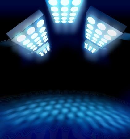 lightbeam: Stadium style premiere lights illuminating blue surface on dark background Stock Photo