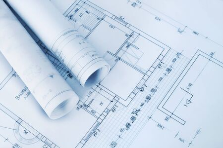 Construction plan blueprint rolls with drawings photo