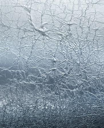Lámina de plata arrugada reflexivo textura de fondo