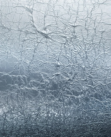 aluminum foil: Wrinkled silver foil pattern reflective texture background
