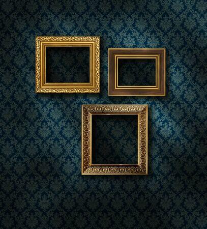 Three gilded frames on dark damask pattern wall paper Stock Photo - 9092510
