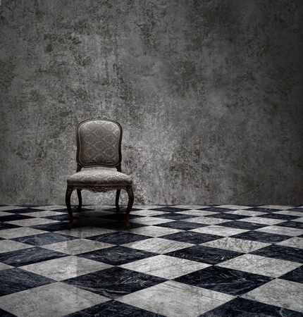 Antique chair in rough patina silver wall and checkered marble floor room photo