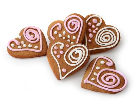 분홍색과 흰색 설탕 glazi 장식 심장 모양 생강 빵