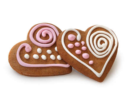 christmas gingerbread: Heart shape ginger breads decorated with pink and white sugar glazing Stock Photo