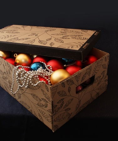 Carton box filled with Christmas decoration balls Stock Photo - 9478521