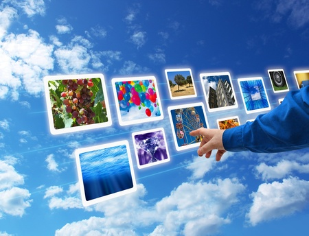 blue widescreen widescreen: Male hand selecting images multimedia information flow Stock Photo