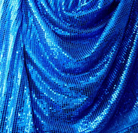 Blue disco glitter reflective fabric sparkling background photo