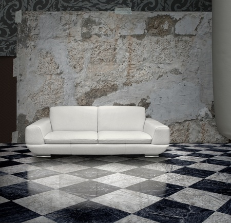 plaster wall: Grunge plaster wall white sofa checkered marble floor Stock Photo