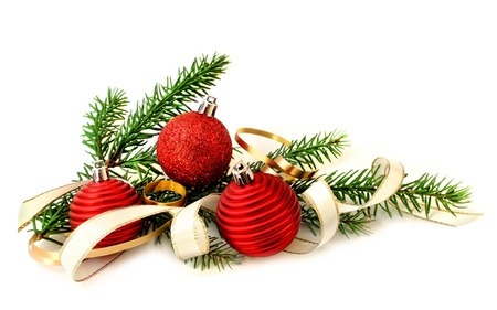Red Christmas balls, ribbon and green branch on white background Stock Photo - 9703858