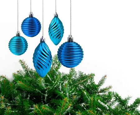Blue Christmas decoration green spruce branches white background Stock Photo - 9703880