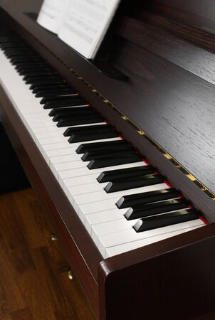 upright piano: Classic upright piano keyboard black and white