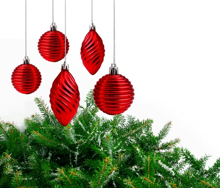 Red Christmas decoration balls, green spruce branches white background Stock Photo - 9703881