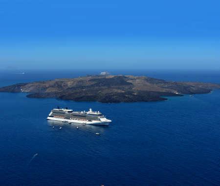 liner transportation: Luxury cruiser in blue Santorini volcano caldera