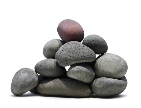 Smooth lava stones stacked pile on white background isolated