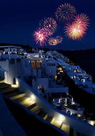 santorini caldera: Fireworks night over Greek holiday resort Oia village Santorini