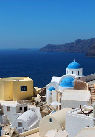 Greek church on Oia Santorini caldera blue sea view photo