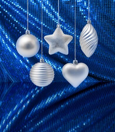 Silver Christmas decoration on blue glitter curtain background Stock Photo - 10199530