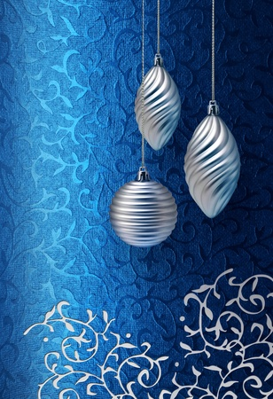 Silver Christmas decoration on blue brocade fabric pattern background Stock Photo - 10227185