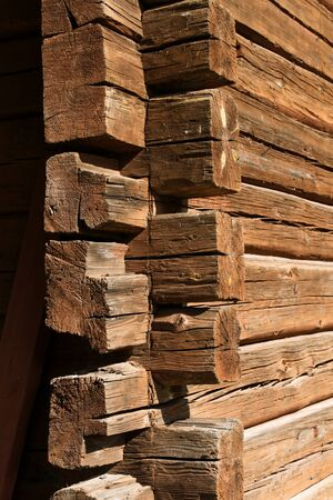 Old decayed wooden log house corner joint Stock Photo - 10399073