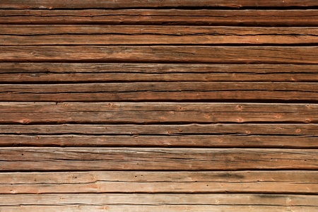 Old brown wooden log house wall horizontal photo