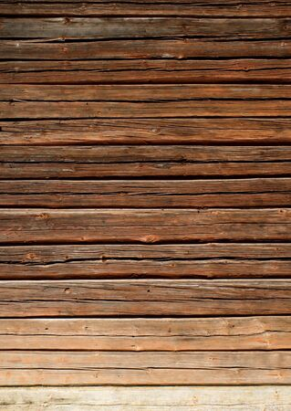 Old brown wooden log house wall vertical Stock Photo - 10399072