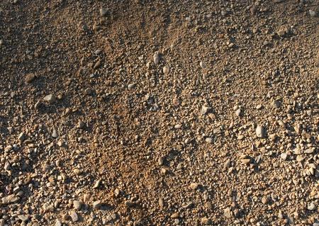 suelo arenoso: Natural marrón arena gruesa de fondo cascajo pequeño Foto de archivo