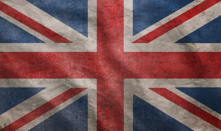Weathered Union Jack UK flag grunge rugged condition waving photo