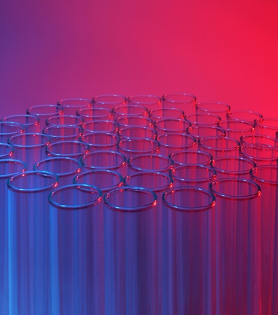 Laboratory test tubes red blue background photo