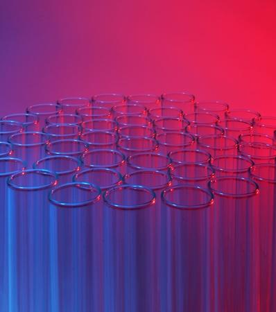 Laboratory test tubes red blue background photo