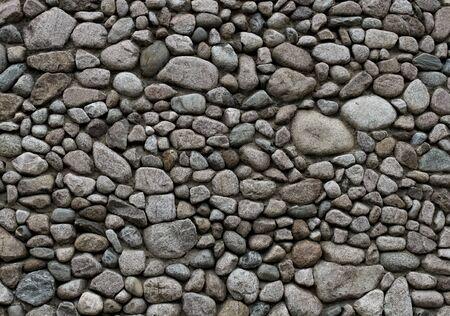 Round gray granite stone wall pattern background Stock Photo - 10763130