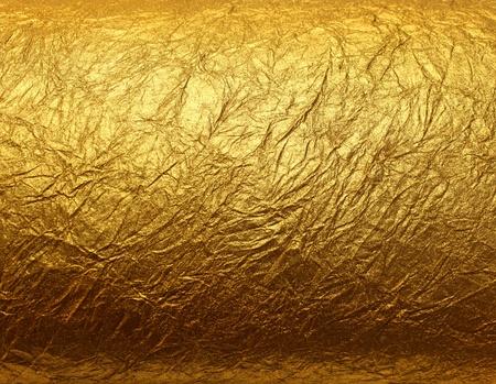 foil: Lucente giallo foglia d'oro foglia texture di sfondo Archivio Fotografico