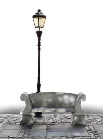 empedrado: Asiento de mármol y streetlight sobre los adoquines de piedra, parcialmente aislado
