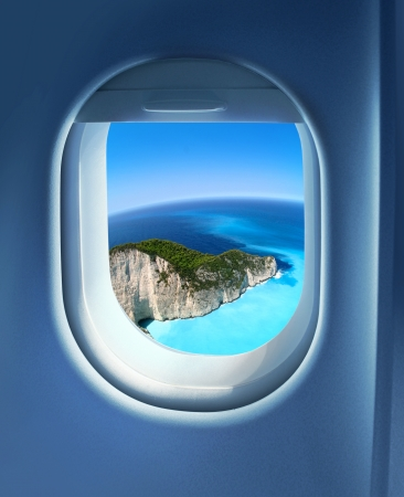 airplane window: Approaching solitaire paradise island holiday destination, jet plane window sky view