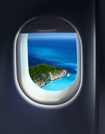 holiday destination: Approaching solitaire paradise island holiday destination, jet plane window sky view