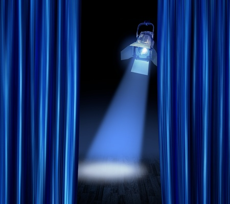 Blue satin curtains reveal stage spotlight lamp beam photo