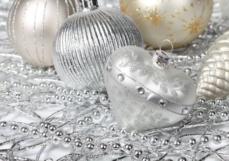 Silver Christmas decoration heart, pearls, cone and balls photo