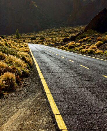 distant: Empty asphalt tarmac road in desert perspective