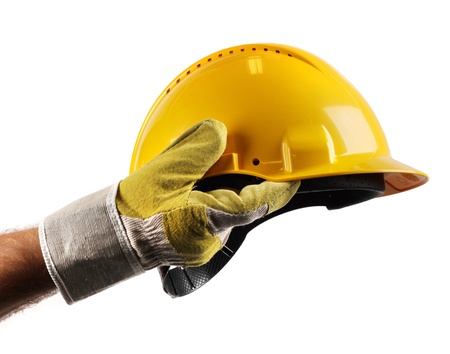 Male workers hand holding modern yellow hard hat Standard-Bild