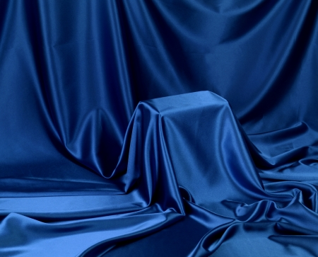 reveal: Something secret veiled under satin silky cloth fabric Stock Photo