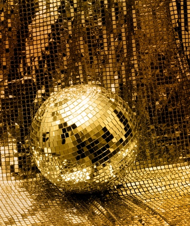 mirror ball: Golden disco mirror ball reflect light on glitter canvas background