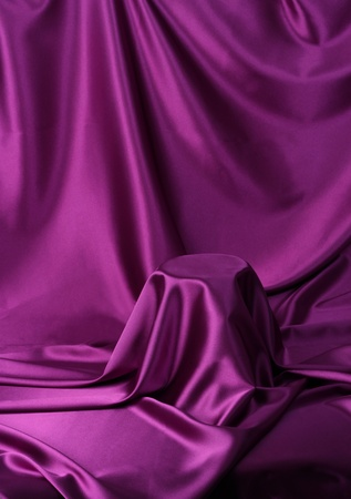 reveal: Something secret veiled under satin silky cloth fabric Stock Photo