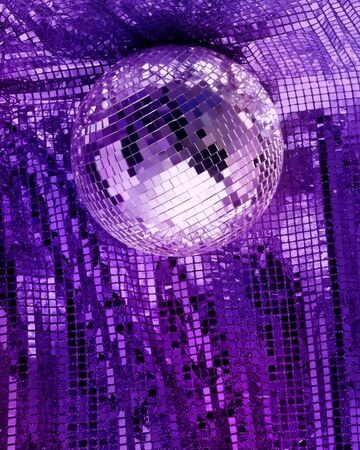 discotheque: Purple disco mirror ball reflect light on glitter canvas background