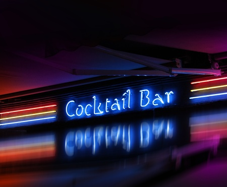 Colorful cocktail bar neon sign glowing on dark background photo