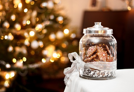 Homemade gingerbread biscuits in glass jar, Christmas background Stock Photo