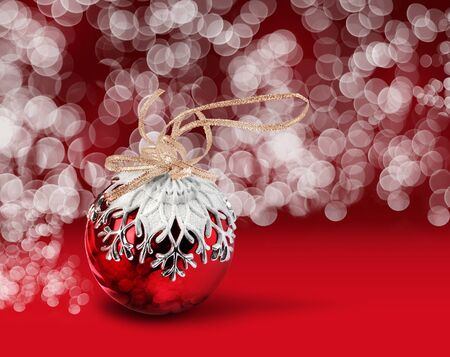 Christmas ball with snowflake decoration, red bokeh background Stock Photo - 12947584