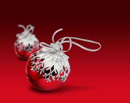 Two Christmas balls with snowflake decoration, vivid red background Stock Photo - 12958024