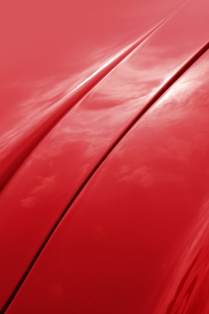 Red car shiny bonnet design curves detail background