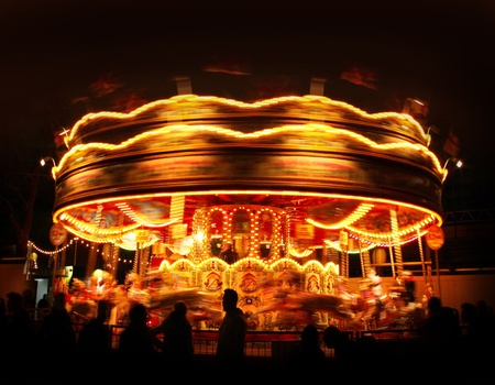 Spinning carousel lights motion in amusement park night