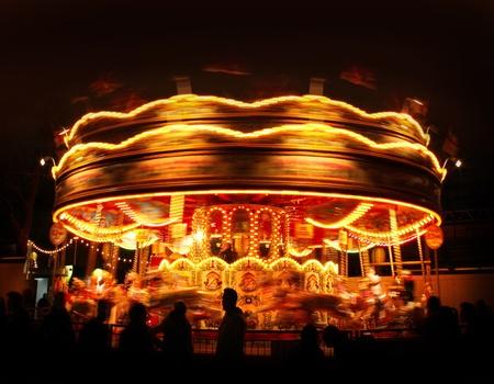 Spinning carousel lights motion in amusement park night