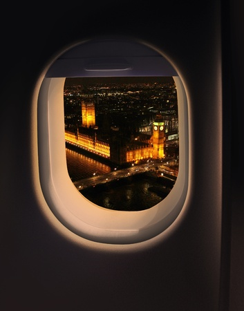 Approaching destination London UK destination, jet plane window night sky view